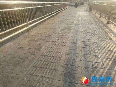 沂龙湾大桥新修非机动车道有些颠簸?道路处:采用铺装新